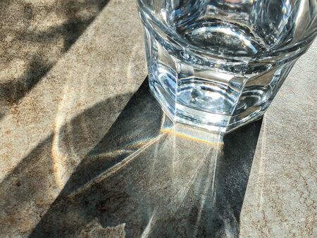 glass of mineral water on stone background of table at outdoor restaurant. top view