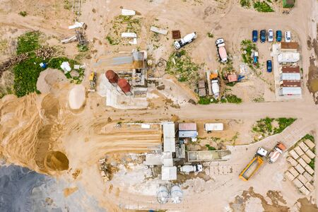 aerial top view of mix concrete production plant with working industrial machines