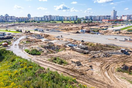 aerial panoramic view of road construction site in suburb residential area