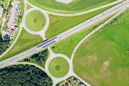 aerial top view of suburb road intersection and green fields in summer time 版權商用圖片