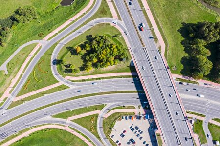 aerial top view of asphalt road intersection. city highway in sunny day. drone image