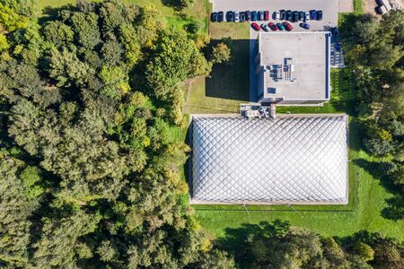 top down view of inflatable tennis court in green summer park. aerial image