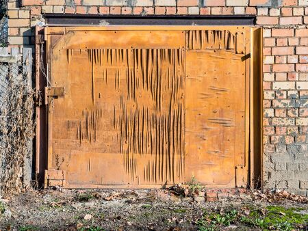 closeup of old weathered and worn out wooden garage door