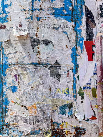 ragged and tattered poster paper texture. torn advertisement posters. grunge urban background