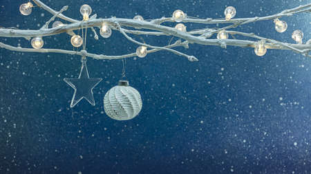 christmas tree decorations and christmas lights on white branch. new year blue festive background. Archivio Fotografico