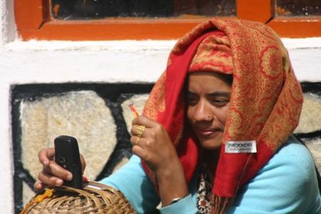 nepali: Nepali woman with mobile phone