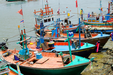 fisherman and boat in sea thai Fishing boats in Thailand Stock Photo - 31154532