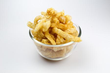 chicharon: Pork Crackling, Pork Rind, Pork Scratchings or Pork Snack in bowl Stock Photo