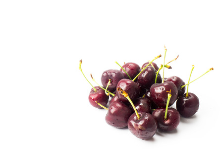 drupe: a small group of cherries arranged in a white background