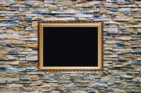 the bright and nice artifical ornamental stone wall with old russian style wooden photo frame with stucco moulding  photo