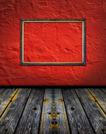 vintage red terracotta interior with empty classic frame hanging on the wall concept dissonance photo
