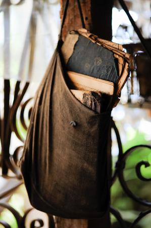 saddlebag: Old saddlebag full of books in rag fair