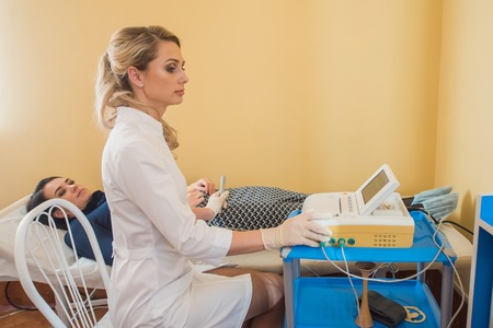 Beautiful gynecologist does cardiotocography of the fetus. A young doctor examines a patien. Checkup. Stock fotó