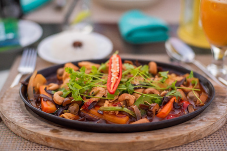 Stir fried chicken with cashew nuts in a pan. Asian food.