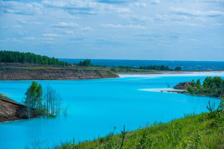 Alkaline solution. Ash dump dumping waste into the water. Ecological catastrophy. Turquoise dead water is like an oasis. The result of the waste plant