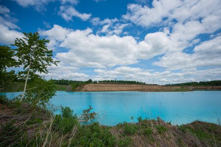 Alkaline solution. Ash dump dumping waste into the water. Ecological catastrophy. Turquoise dead water is like an oasis. The result of the waste plant in an artificial reservoir
