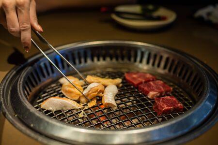 Fresh meat. Grilling meat in a Korean restaurant. Traditional Korean food.