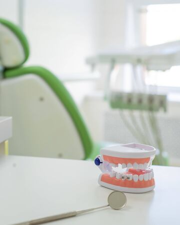 Sterile instruments are in the dentists office. The mirror and the layout of the jaw lie on the table of the orthodontist. Oral hygiene, caries prevention, examination. Stock Photo