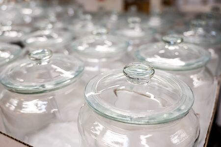 A group of empty cans with a lid. Rows of glass containers in a store. Close-up Reklamní fotografie