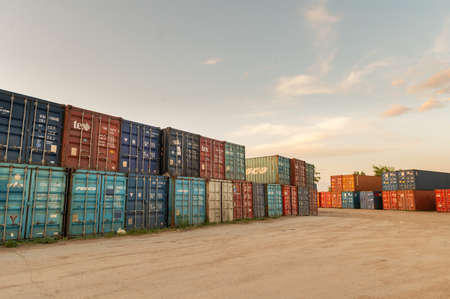 Warehouse of freight containers. Metal boxes loaded with each other in several rows before transportation. Terminal transport containers. Editöryel