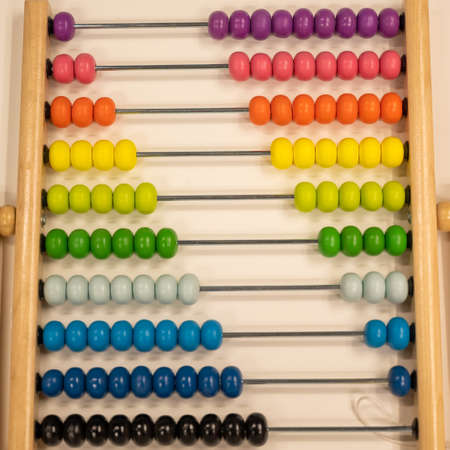 Bright colored hand abacus. Childrens wooden toy for the study of arithmetic.