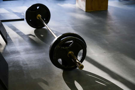 Barbell on the floor in the gym