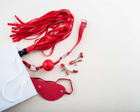 Top view of a red set in a white paper bag on a white background. Flat lay from toys