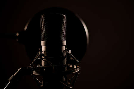 Professional microphone on a dark background