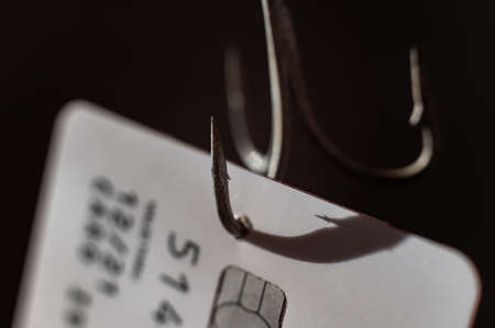Close-up of a credit card on a fishing hook