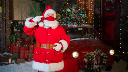 Portrait of santa claus wearing a protective mask. Winter holiday during the coronavirus pandemic