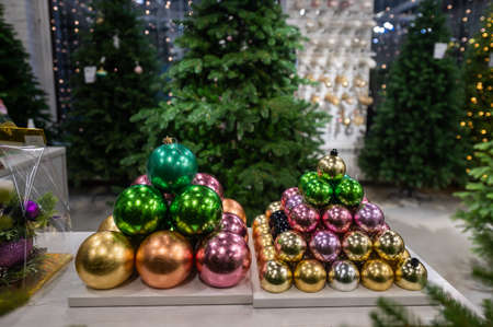 Christmas balls on the stand. Close-up of Christmas toys in a store