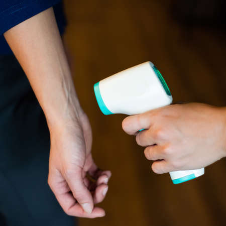Body temperature measurement with infrared wrist thermometer.