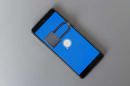 Mobile phone with messenger logo signal and lock on white background.