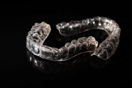 Removable plastic retainers on black background