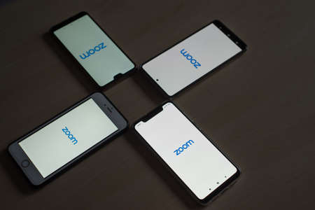 November 8, 2020 Russia, Novosibirsk: Smartphones with zoom logo on the screen. Application for online communication 報道画像