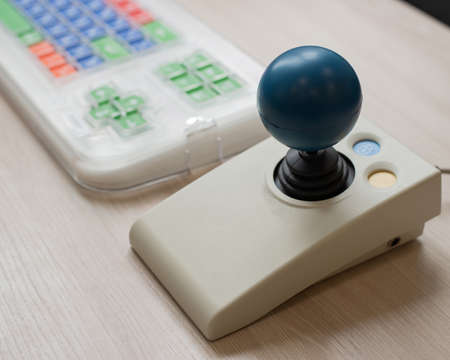 Close-up of a specialized computer mouse and keyboard for people with cerebral palsy. 写真素材