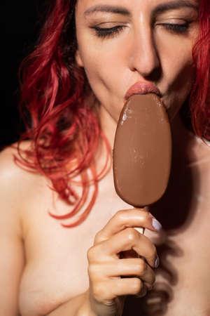 Seductive woman eats ice cream sexually