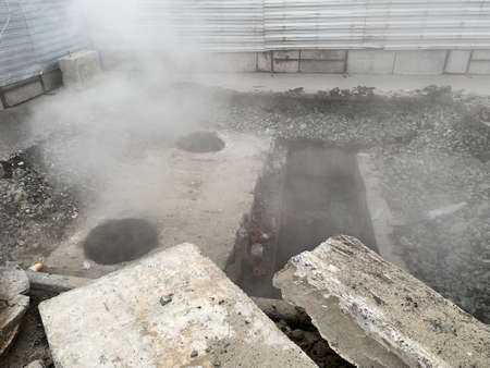 Repair of the heating main. The underground pipe through which steam flows is damaged 写真素材