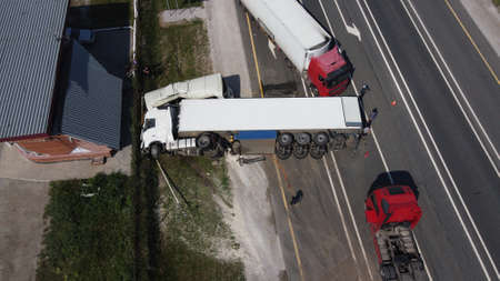 Top view of a car accident involving a truck and a bus. Filming from a drone
