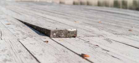 Close-up of a wooden floor with a sticking out board. 写真素材