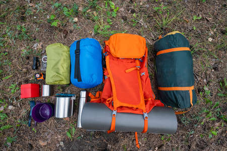 Hiking equipment. View from above. Pine forest