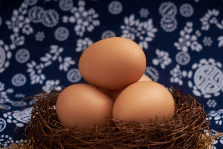 Eggs placed on blue floral cloth