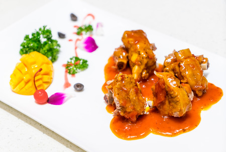 Grilled pork ribs with sweet and sour sauce