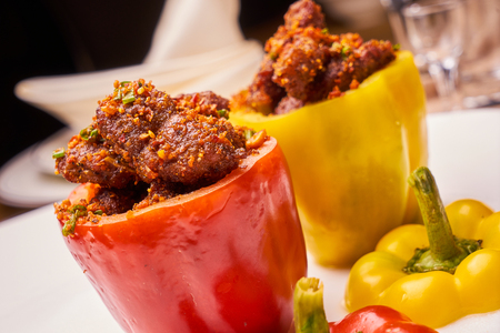 Grilled meat stuffed in red and yellow pepper 写真素材