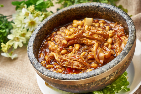 Traditional gourmet braised duck feet with soybeans