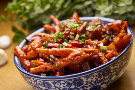 Traditional food, braised chicken feet with preserved vegetables 写真素材