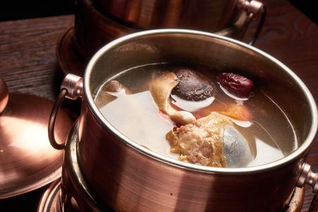 Big bone soup in copper pot