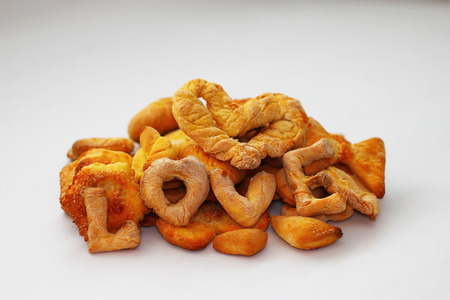 love declaration: Cookies with the curly letters of the word love on a wooden background