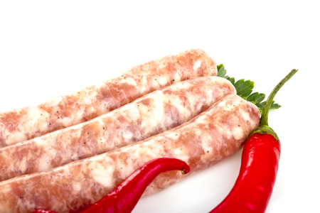 hot pepper: Grilled sausage with red hot pepper and tomatoes Stock Photo