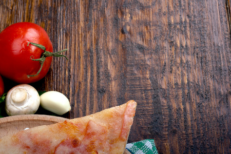 margarita pizza: Margarita pizza with cheese and tomatoes on a wooden table